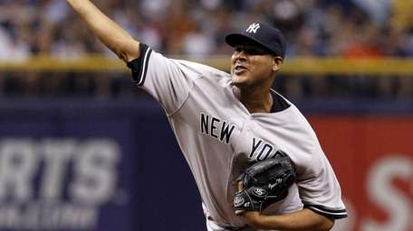 Ivan Nova of the Yankees pitches during the