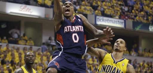 Atlanta Hawks' Jeff Teague shoots against Indiana Pacers'