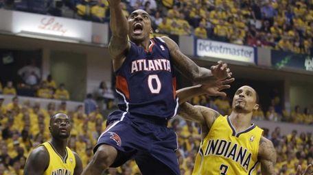 Atlanta Hawks' Jeff Teague shoots against Indiana Pacers'
