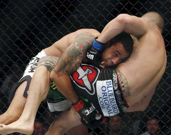 Fabricio Werdum, left, and Travis Browne fight in