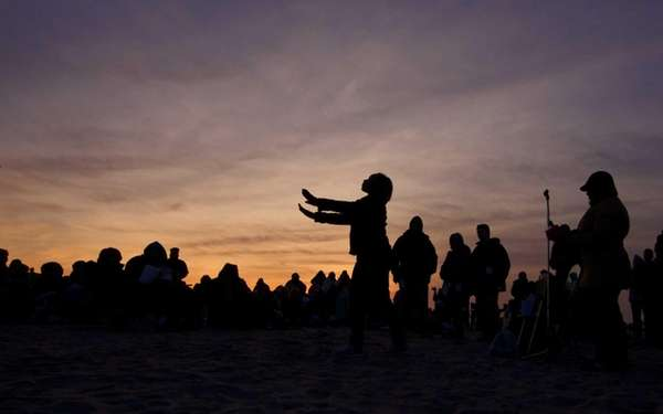 Worshippers gather for the sunrise Easter service at