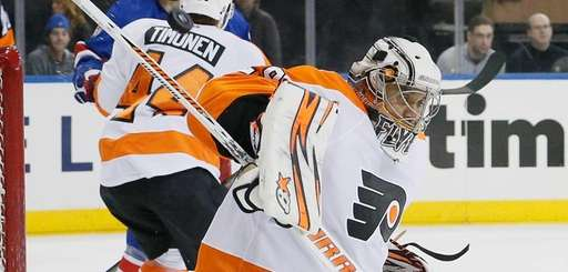 Philadelphia Flyers goalie Ray Emery makes a save,