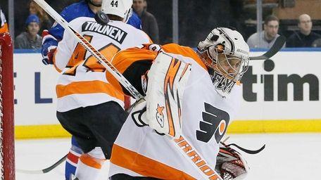 Philadelphia Flyers goalie Ray Emery makes a save,
