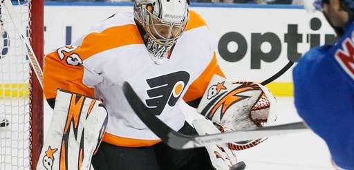 Goalie Ray Emery of the Philadelphia Flyers makes