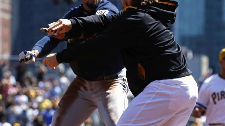 The Pittsburgh Pirates' Travis Snider, right, takes down