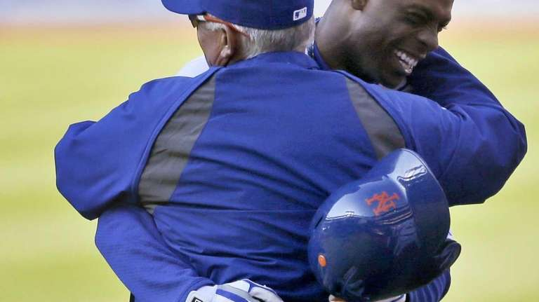 Curtis Granderson, right, hugs manager Terry Collins after