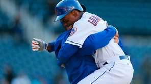 Curtis Granderson is hugged by Anthony Recker after