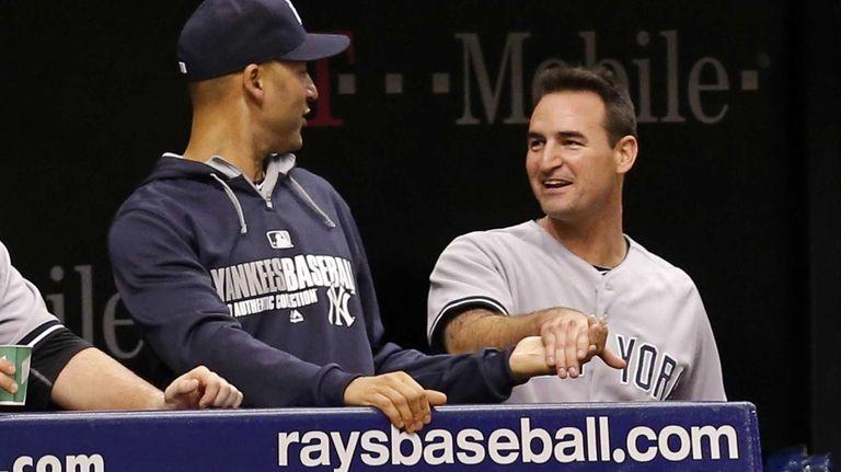 Dean Anna, right, is congratulated by teammate Derek