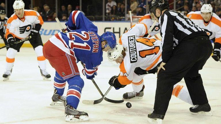 Rangers center Derek Stepan faces off against Philadelphia