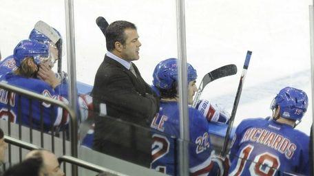 Rangers head coach Alain Vigneault looks on against