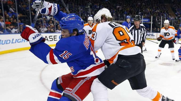 Derek Dorsett of the Rangers battles for the