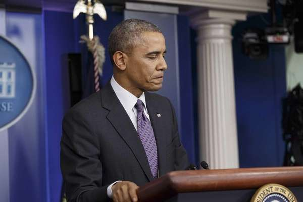President Barack Obama pauses as he speaks in