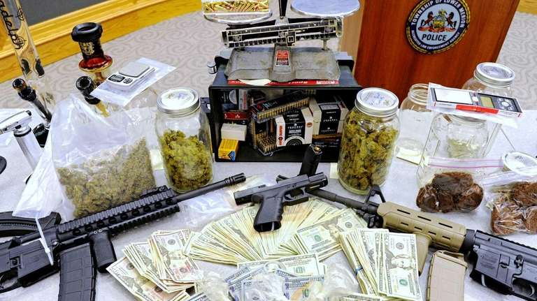 This photo shows drugs, money, guns and other