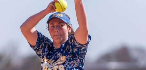 East Meadow's Sandra Foster (9) delivers a pitch