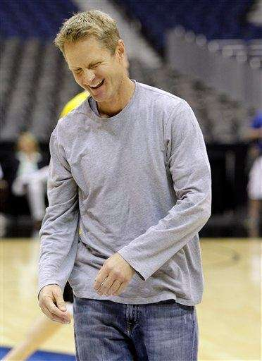 Former NBA player Steve Kerr reacts while participating