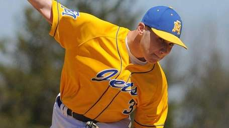 East Meadow starting pitcher Joe Minucci delivers to