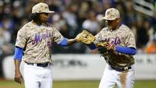 Jenrry Mejia high fives Ruben Tejada after he