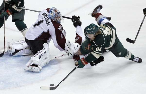 Minnesota Wild center Mikael Granlund (64) shoots the