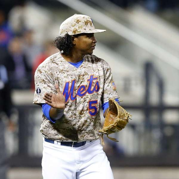 Jenrry Mejia walks to the dugout after the