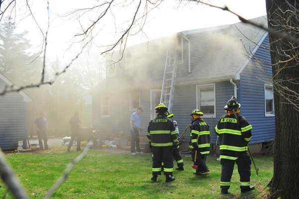 Firefighters and police work at the scene of