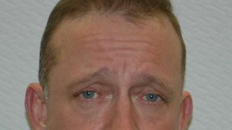 Eric Axelson, 52, of East Patchogue, seen here