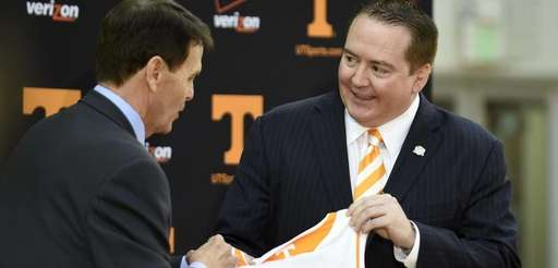 Donnie Tyndall, right, is introduced as Tennessee men's