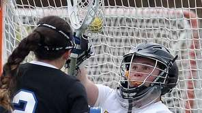 Wantagh goalie Grace Beshlian makes a save on