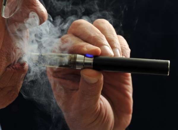 A smoker demonstrates an e-cigarette in Wichita Falls,