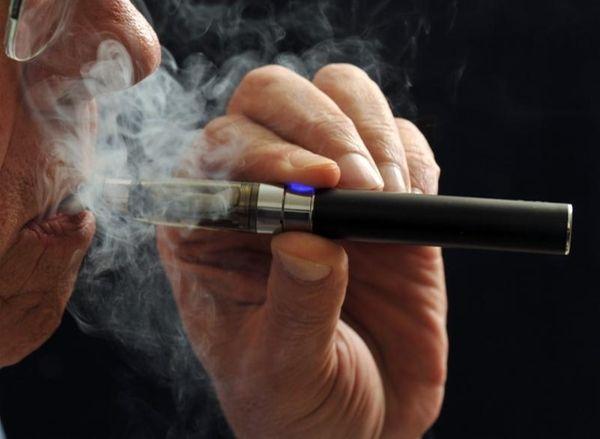 A smoker demonstrates an e-cigarette in Wichita Falls,