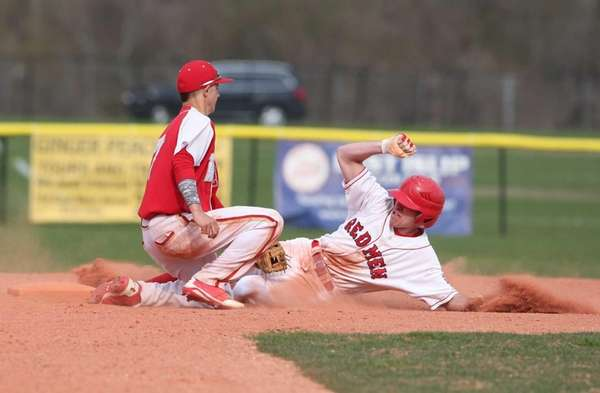East Islip's Jared Vuolo gets tagged out by