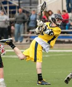 Massapequa's Ian Kirby scores against Syosset in a