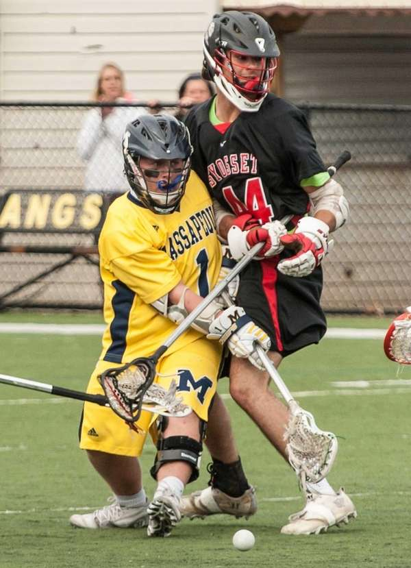Massapequa's Jim Byrns, left, scores as Syosset's EJ Aronson watches in a Nassau boys lacrosse game on Tuesday, April 22, 2014.