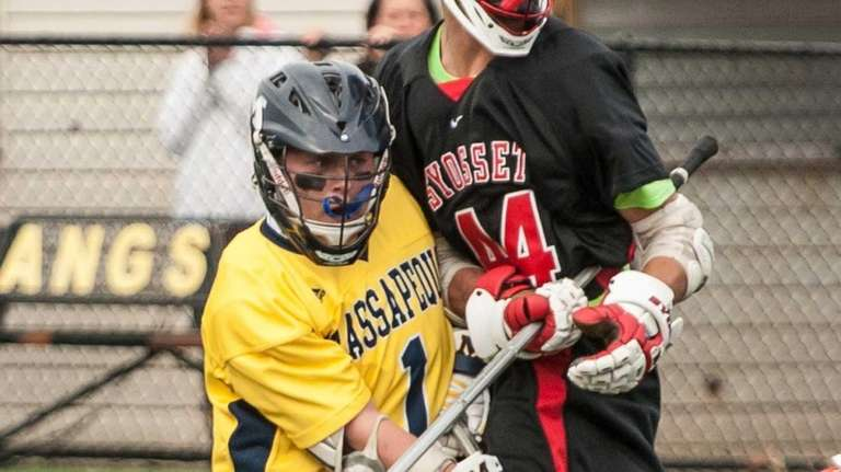 Massapequa's Jim Byrns, left, scores as Syosset's EJ