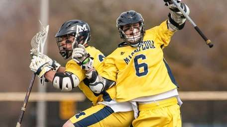 Massapequa's Ian Kirby, right, leaps in celebration after