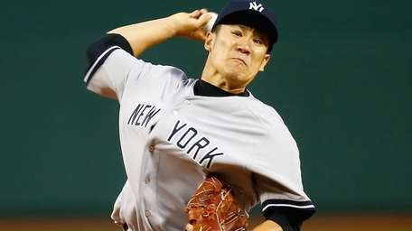 Masahiro Tanaka delivers a pitch against the Boston