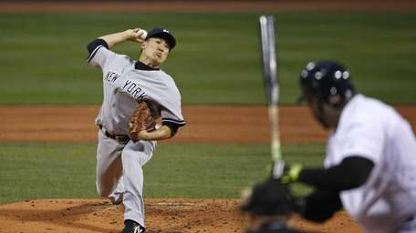 Masahiro Tanaka delivers a pitch to Boston Red