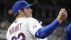 Mets pitcher Matt Harvey looks on from the