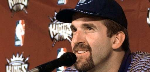 Newly-acquired free agent center Bill Wennington smiles as