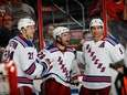 Martin St. Louis, center, celebrates his goal at