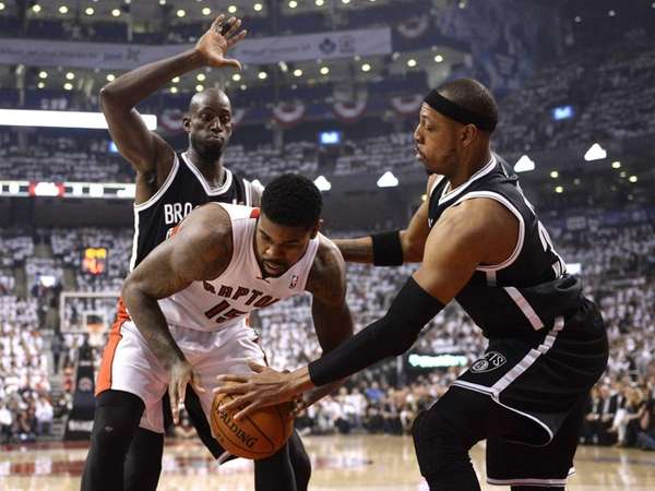 Toronto Raptors forward Amir Johnson, front left, battles