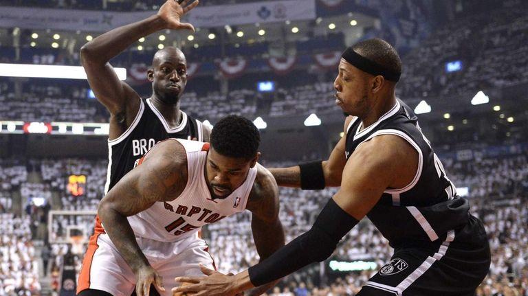 Toronto Raptors forward Amir Johnson, front left, battles