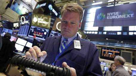 Trader John Bowers works on the floor of