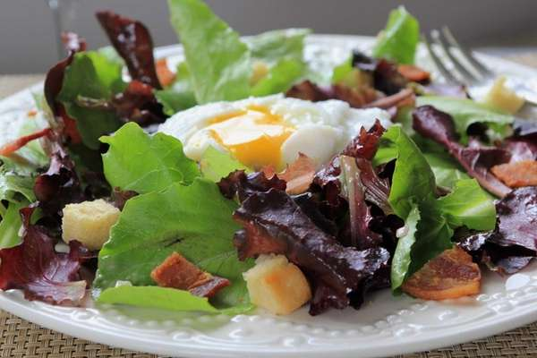 This delicious bistro salad is topped with bacon