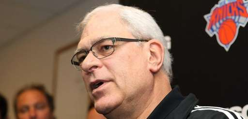 Phil Jackson talks to the media at the
