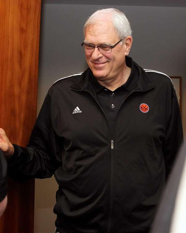 Phil Jackson arrives to talk to media at