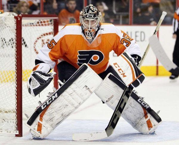 Philadelphia Flyers goalie Steve Mason faces the action