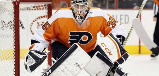 Philadelphia Flyers goalie Steve Mason faces the action