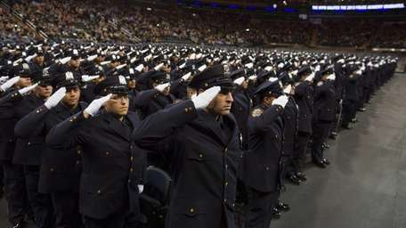 Newly sworn NYPD officers stand at attention just