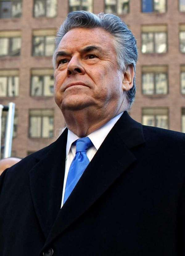 U.S. Rep. Peter King stands before a news