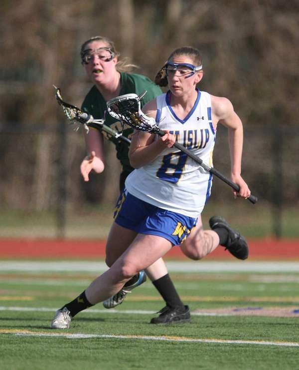West Islip's Lindsay Darrell carries the ball upfield